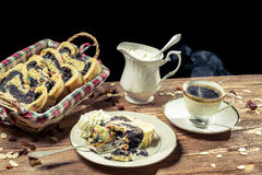 Hot coffee and poppy seed cake with nuts Stock Photos