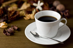 Hot coffee and potpourri. Coffee set on the wooden table Stock Photography