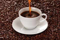 Hot coffee pouring into a cup Stock Photography