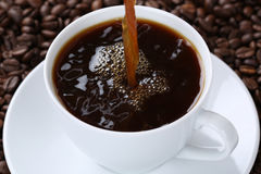 Hot coffee pouring in cup Stock Photography