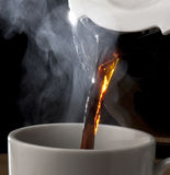 Hot Coffee Pouring From The Pot royalty free stock photography
