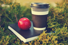 Hot coffee, red apple and book Royalty Free Stock Photography