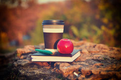 Hot coffee, red apple and book Royalty Free Stock Photo