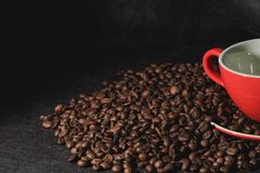 Coffee in red cup and coffee beans are the background. Hot coffee in red cup and coffee beans are the background Stock Photos