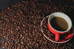Coffee in red cup and coffee beans are the background. Hot coffee in red cup and coffee beans are the background Stock Images