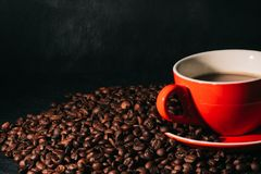 Coffee in red cup and coffee beans are the background. Hot coffee in red cup and coffee beans are the background Stock Photography