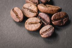 Coffee beans are the background. Hot coffee in red cup and coffee beans are the background Royalty Free Stock Photos