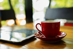 Hot coffee in the red cup Royalty Free Stock Image