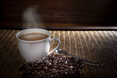 Hot coffee and roast bean on wood Stock Photo