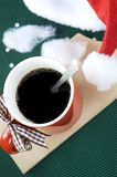 Hot coffee with santa hat Stock Images