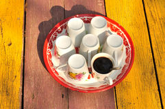 Hot coffee with set of cup on tray. Black coffee stock photography