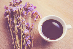 Hot coffee and statice flowers for decorated stock photography