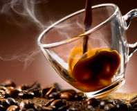 Hot coffee 'steaming poured into a cup Stock Photos