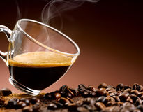 Hot coffee 'steaming poured into a cup Royalty Free Stock Image