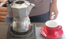 Hot coffee stream flowing out from moka pot stock video