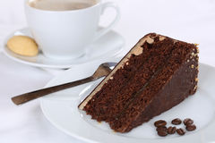 Hot coffee and sweet cake chocolate tart dessert Royalty Free Stock Images