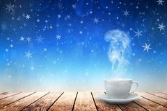 Hot coffee on the table on a winter background stock photos