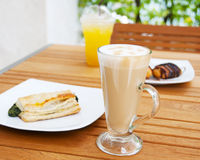 Hot Coffee. On a table with snacks Stock Photo