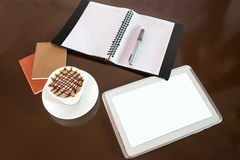 Hot coffee and tablet Stock Photos