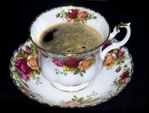 Hot coffee tea. Hot coffee served in  china cup and saucer painted with flowers Royalty Free Stock Photography