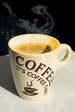 Hot Coffee tea. Hot smoking coffee served in a white cup Royalty Free Stock Photo