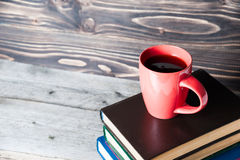 Hot coffee or tea, cocoa, chocolate cup on book with copy space for text Stock Image