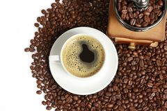 Hot coffee, Vintage manual coffee grinder with coffee beans on wooden spoon Royalty Free Stock Photo