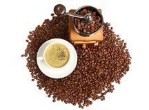 Hot coffee, Vintage manual coffee grinder with coffee beans on wooden spoon Stock Image