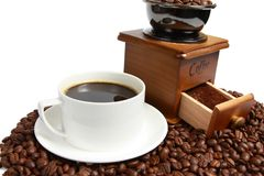 Hot coffee, Vintage manual coffee grinder with coffee beans on wooden spoon Royalty Free Stock Images