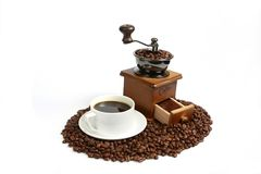 Hot coffee, Vintage manual coffee grinder with coffee beans on wooden spoon Royalty Free Stock Image