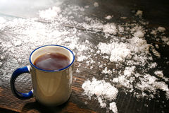 Hot Coffee in Vintage Mug and Snow in Cold Winter Royalty Free Stock Photo