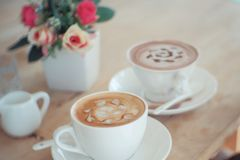 Hot coffee in vintage style royalty free stock photography