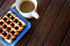 Hot coffee and Waffles with chocolate sauce on wooden table background. Have some space for write wording royalty free stock photo