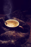 Hot coffee in warm scarf Royalty Free Stock Images