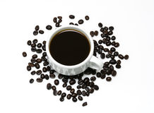 Hot coffee in the white cup and coffee beans Royalty Free Stock Image