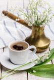 Morning coffee in spring and lilies of the valley for mood. Royalty Free Stock Photos