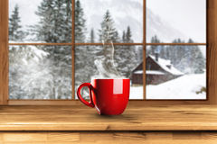 Hot coffee in winter Royalty Free Stock Image