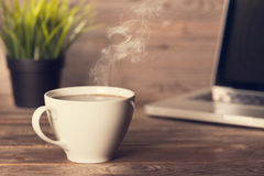 Hot coffee on wooden office desk Royalty Free Stock Photography