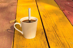 Hot coffee on wooden plank Stock Photo