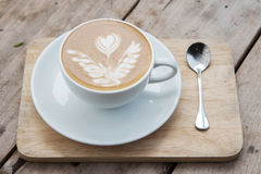 Hot coffee on wooden table. Cappuccino Royalty Free Stock Images