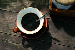 Hot coffee on a wooden table Royalty Free Stock Images