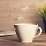 Hot coffee on wooden work desk Royalty Free Stock Image