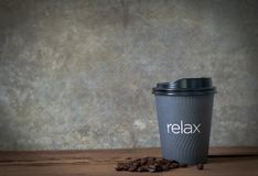 hot coffee on woonden table with coffee bean royalty free stock photography