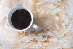Hot coffee on worn paper with coffee stains. And rough royalty free stock images
