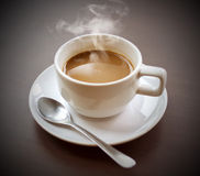 Hot coffee on your desk. Stock Images