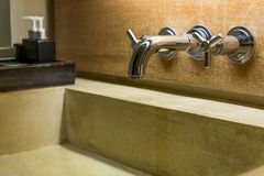 Hot cold separated shiny metal water tap Stock Photography