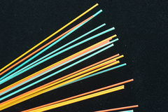 Hot colorful fiber optics. Hot colorful fiber optics on a black background Royalty Free Stock Photo