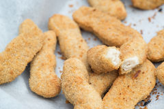Hot cooked chicken goujon in breadcrumbs for lunch Stock Photography