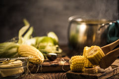 Hot corn on the cob with butter. Healthy autumn snack Royalty Free Stock Photo