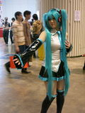 Hot Cosplay Girl with Long Teal Hair Royalty Free Stock Photography